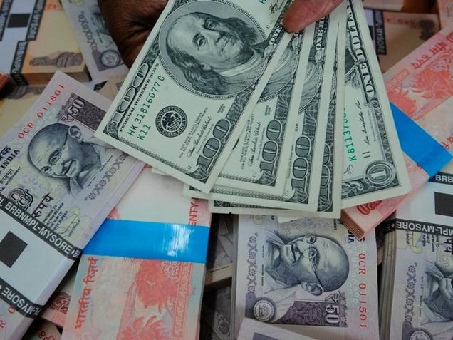 Indian Rupee Surrenders 22 Paise, Sensex continues to rise.