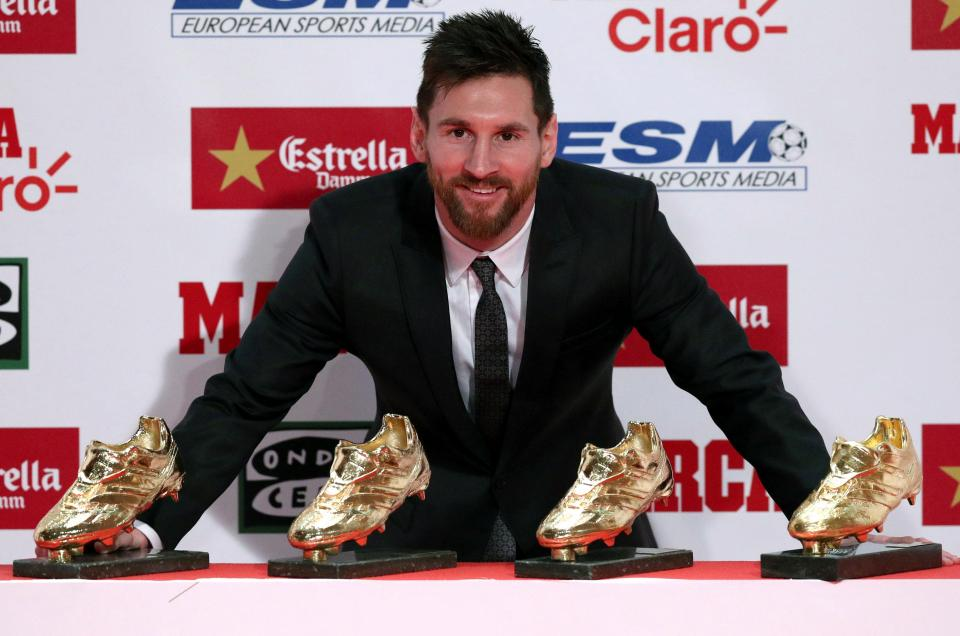 Lionel Messi poses with his four Golden Shoe awards