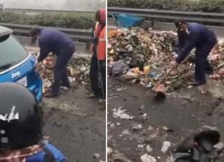 Delhi Cop Steers Away Garbage At The DND Flyway