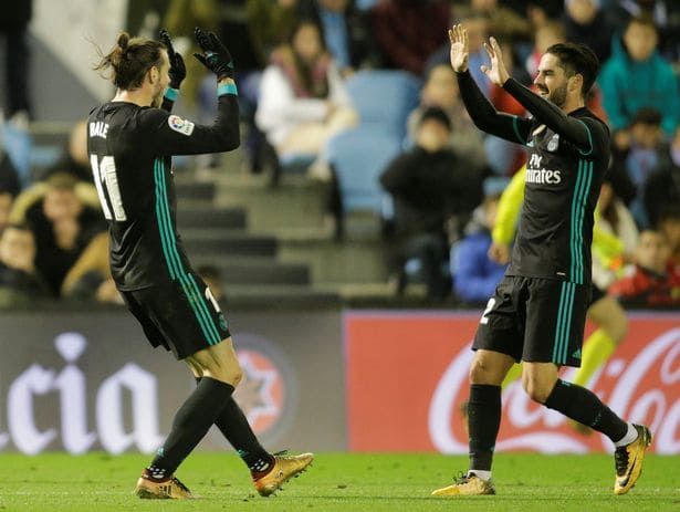 Gareth Bale celebrates scoring their second goal with provider Isco