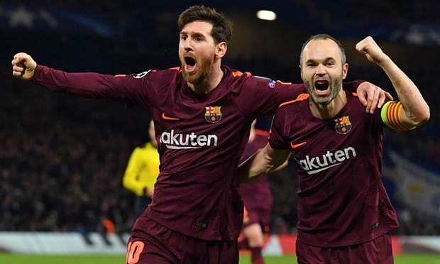 Lionel Messi celebrates with Andrés Iniesta after the Argentinian scored Barcelona's equaliser at Stamford Bridge