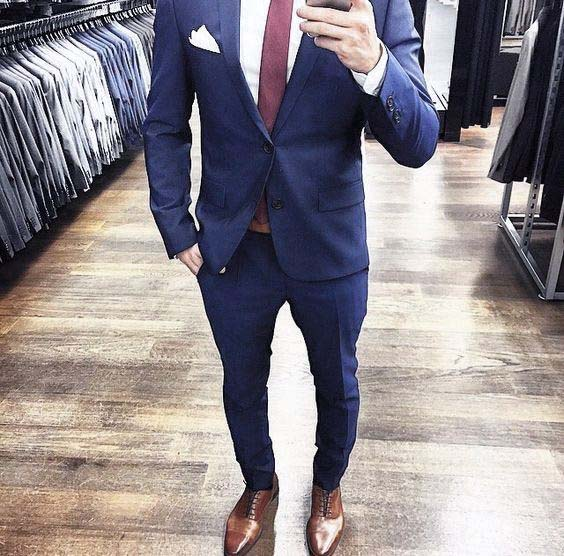 navy color suit with brown shoes