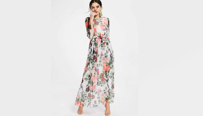 floral print maxi dress with flower-shaped earrings