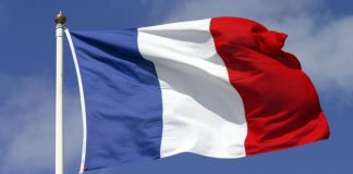 why are schools in France to display flags in classrooms