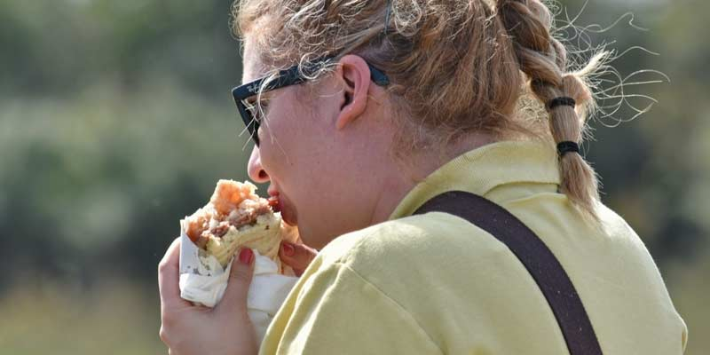 Women Eating Burger | Facts About Digestion