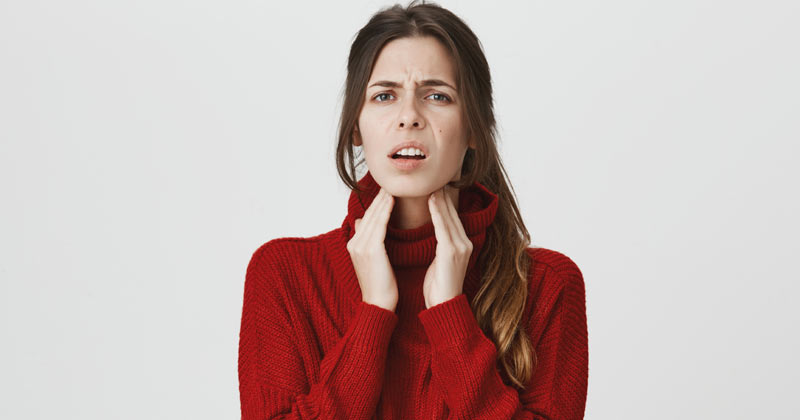Woman Experiencing Throat Pain | Remedies for Sore Throat