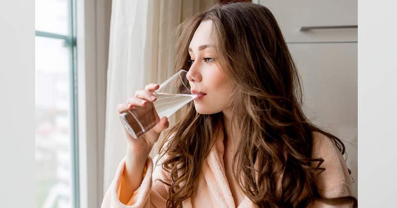 Woman Drinking Water | Sore Throat Remedies