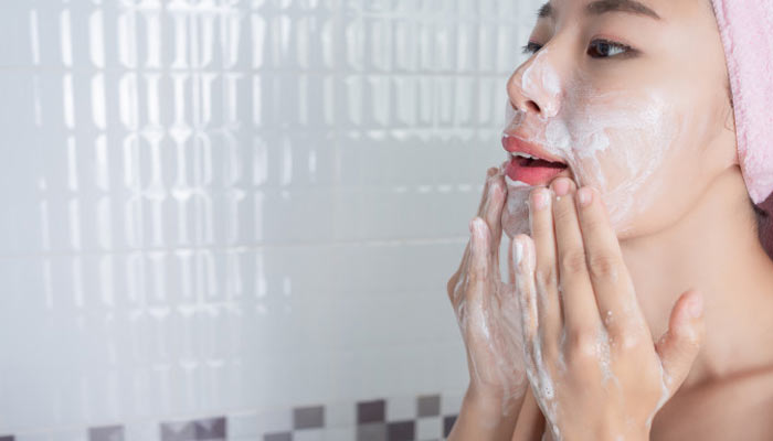 Women Scrubbing her Face   types of exfoliation   How to Exfoliate