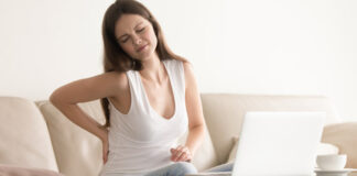 Woman Experiencing Back Pain | Exercises For Back Pain and Good Posture