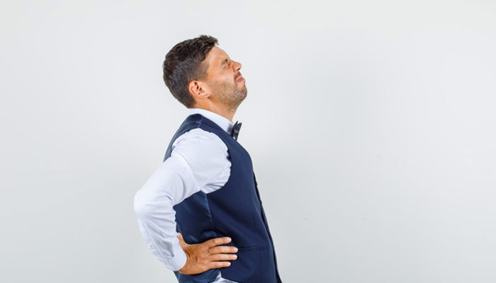 Man Experiencing Back Pain | how to relieve back pain | Exercises For Backpain