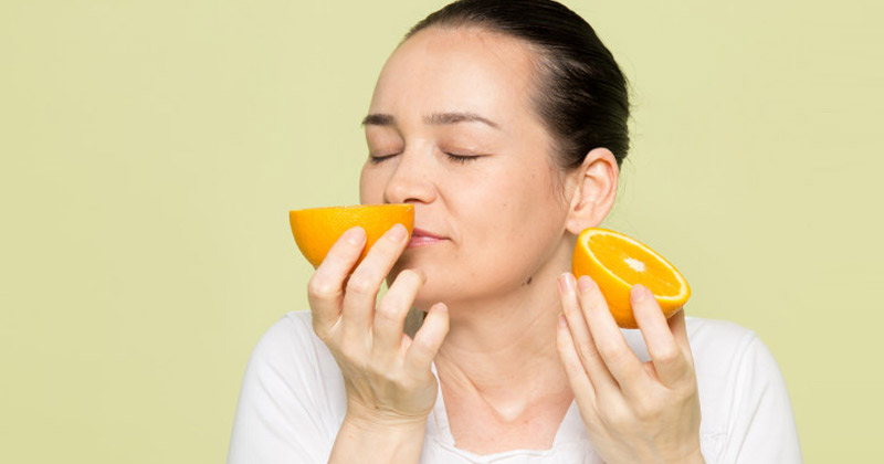 Woman Smelling a Lemon | Anosmia