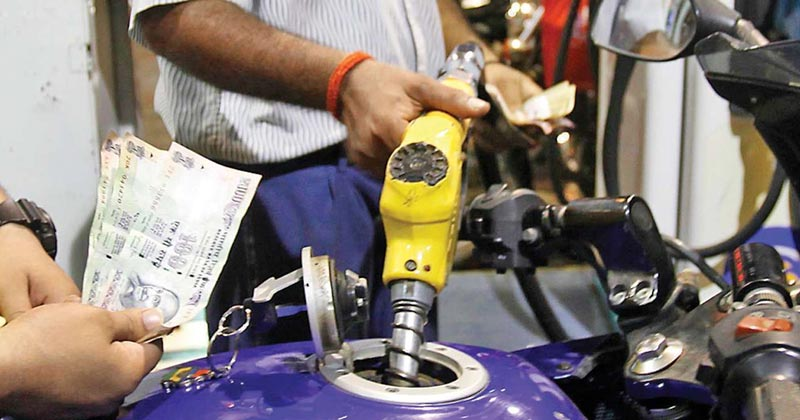 A person getting fuel filled in his bike | Future Call on Rise in Fuel Price India