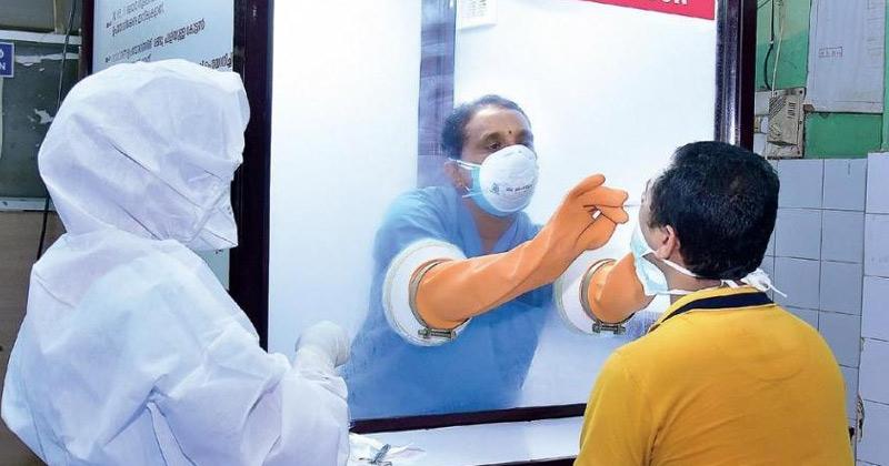 A person undergoing Covid test in Kerala | Rise in Covid Cases Kerala