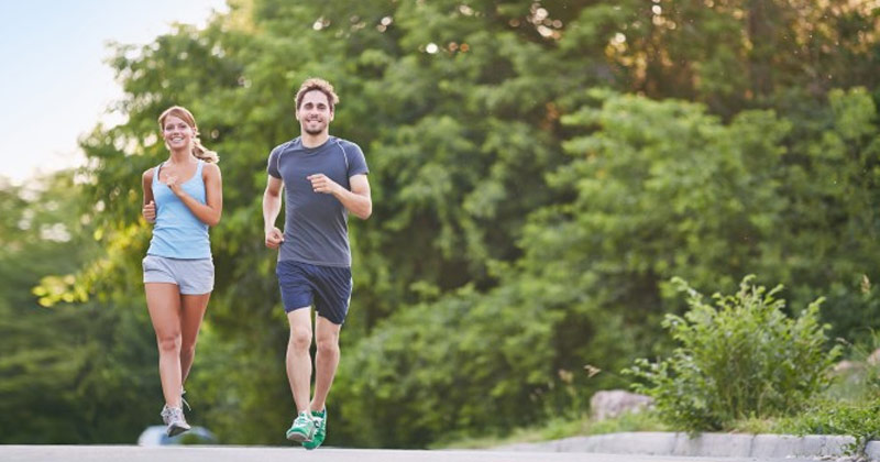 Man and Woman Jogging | Benefits of Regular Exercise