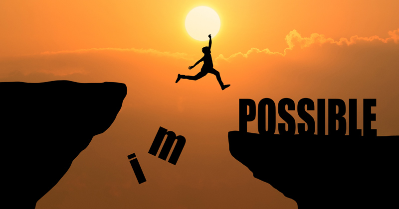 An illustration of a person jumping across a cliff | Self-motivating Habits