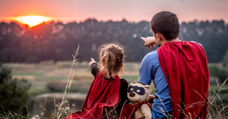 Father and Daughter Wearing Super hero costume and staring at sun   Zodiac Signs As Dads